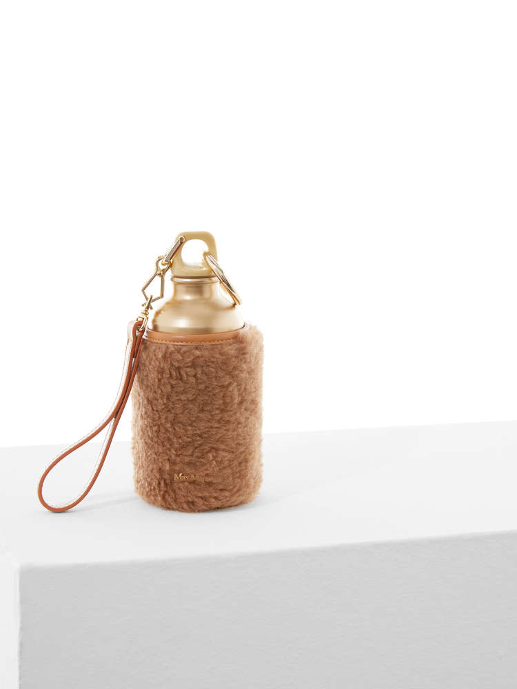 Water bottle with teddy fabric cover