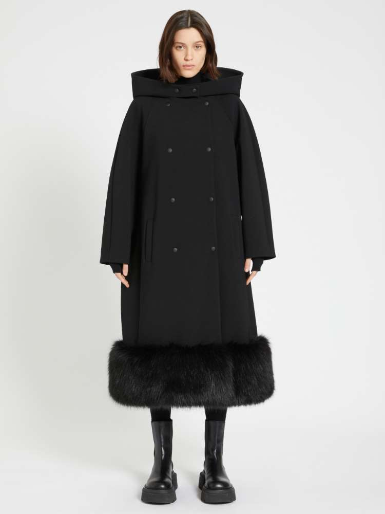 Coat with contrasting flounce